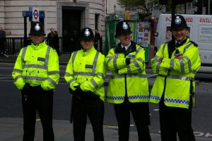 Four London Policeman in high visibility jackets